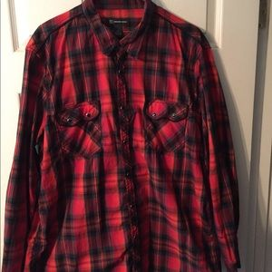 Red, orange and black snap front western shirt.